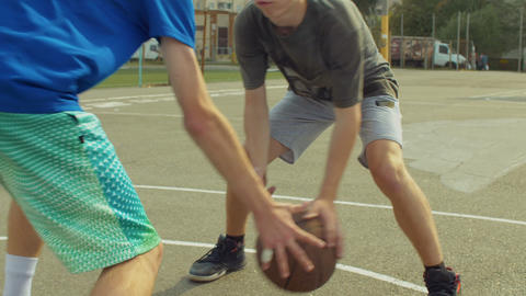 Streetball defender causes turnover of offensive player Footage