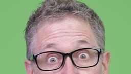 Close-up shot of mature businessman wearing eyeglasses Footage