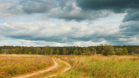 Panoramic timelapse of autumn landscapes, rain clouds fly over field Footage