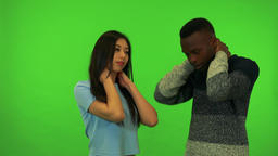 A young Asian woman and a young black man stretch - green screen studio Footage
