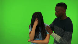 A young Asian woman cries and a young black man comforts her - green screen Footage