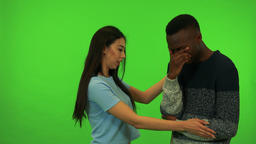 A young black man cries and a young Asian woman comforts him - green screen Footage