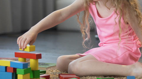 Early education, smart female kid playing with toy blocks at home, childhood Footage