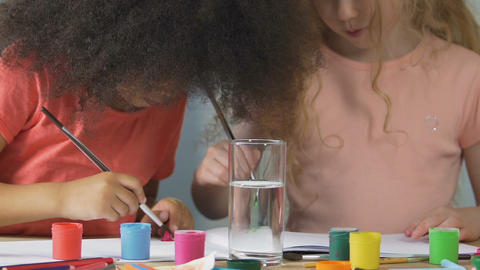 Young students using acrylic paint at drawing lesson in kindergarten, education Footage