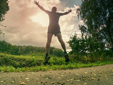 Attractive and tall runner man in slim sportswear running Photo