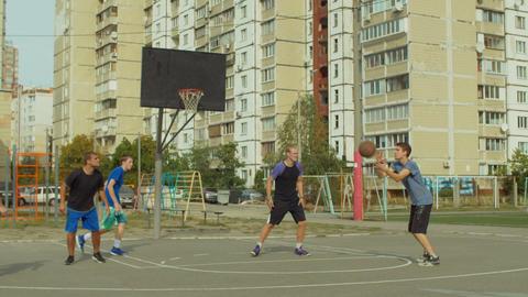 Offensive streetball team scoring field goal on court Footage