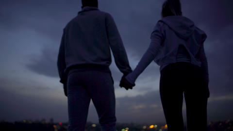 Lovely couple holding hands, romantic secret place for dating, relationship Footage