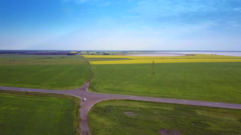 rural landscape with fields and car on ground crossroad Footage