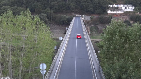 Red car crossing a concrete bridge 41 Footage