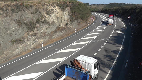 Heavy trucks that run on a four-lane road with a curve to the left 50 Footage