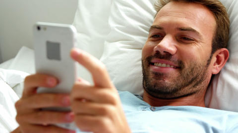 A man is texting in his bed Live Action