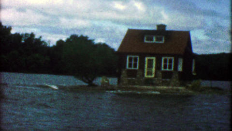 1955: Tiny island house completely surrounded by lake waters Footage