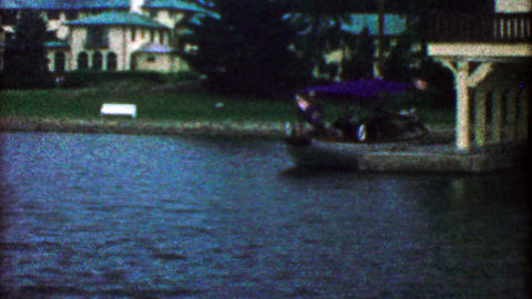 1955: Wealthy lakeside mansion with fancy matching boathouse Footage