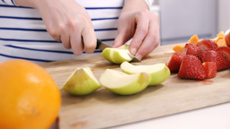 Close up on a woman carving some fruits Live Action