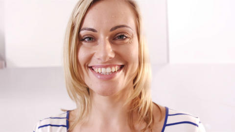 Blonde woman smiling and holding a fruit bowl Stock Video Footage
