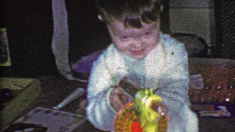 1953: Boy shoots futuristic windup toy tommy gun Christmas morning Footage