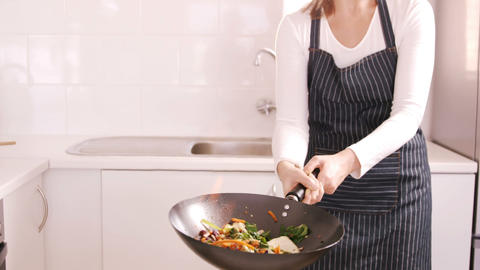 Blonde woman preparing the meal Live Action