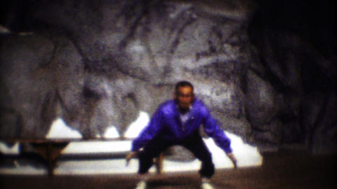 1974: Traditional native Inuit people dance performance from solo male Footage