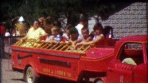 1957: Kids riding mini firetruck ride at Catskill Game Farm zoo Footage