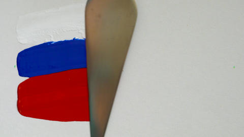 Creating a flag of Russia with acrylic paints and palette knife Footage