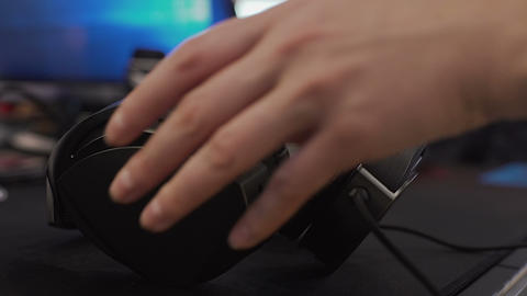 Woman wearing headphones in office, typing on computer keyboard, office work Live Action