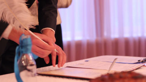 Bridegroom neatly signing marriage certificate, couple in love creating family Live Action
