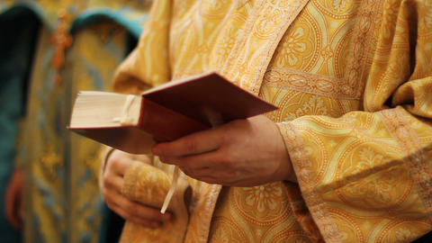 Priest beginning divine liturgy, crossing himself and praying god for blessing Live Action