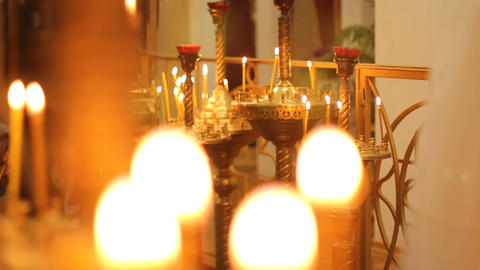 Bright church candle lights flickering, illuminating path to god for lost souls Live Action