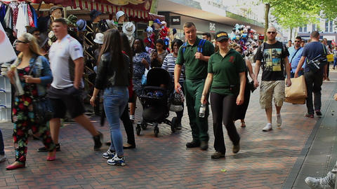 Medical Attendants walking the street during a busy, shopping day in Birmingham Archivo