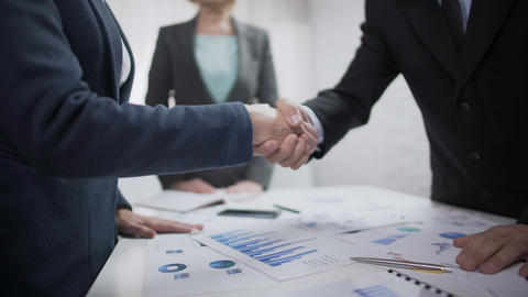 Company representatives handshaking after contract sign, partnership symbol Footage