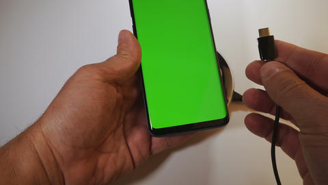 Wired vs wireless mobile phone charging with green screen locked & unlocked GIF