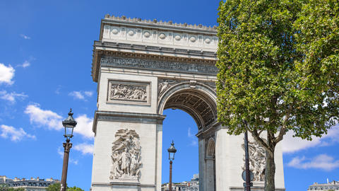 Clouds passing over world famous Arc de Triomphe in time lapse effect Footage