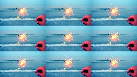 Burning one Bengal fire in hand against the background of a sea ocean wave Footage