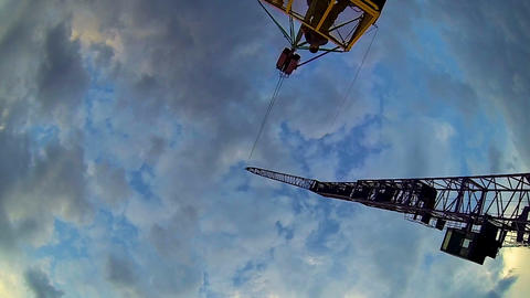 Bottom view of crane lifting man basket, dangerous occupation, industrial Footage