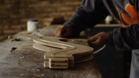 Craftsman Making A Wooden Musical Instrument GIF