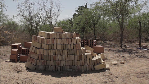 Bricks On The Farm Next To A Wire Fence GIF