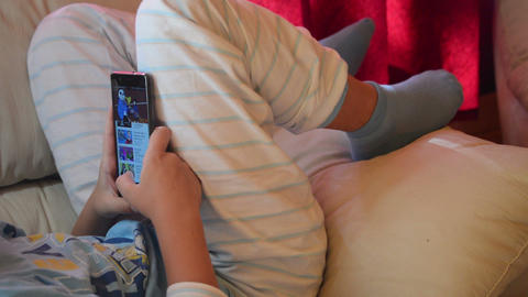 teenager playing game on smartphone in home Animation