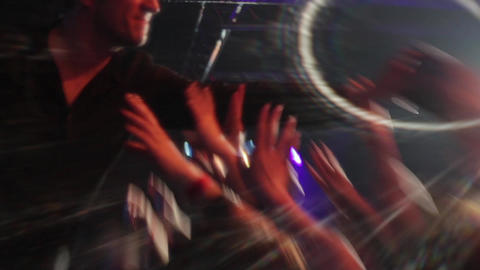Hands stretched to the lead singer who has performed and shared disks that fans  Footage