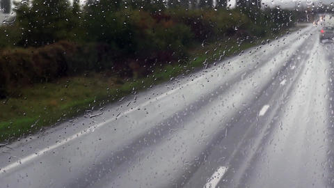 Oncoming cars are seen through the windscreen of a bus full of splash 62 Footage