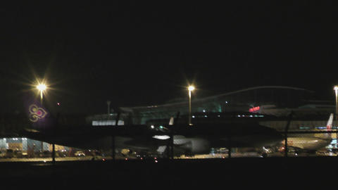 Thai Airways Boeing 777 taxiing after landing at night Live Action