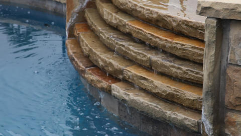 Water in a pool falling down steps Live Action