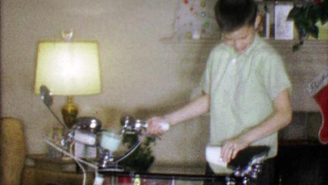 1963: Boy loves ten speed bike Christmas gift in family room Footage