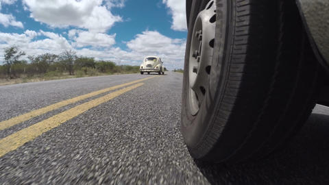 Driving on road while VW Volkswagen Beetle overtakes Footage