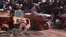 dump truck carrying stone blocks in marble stone quarry Footage