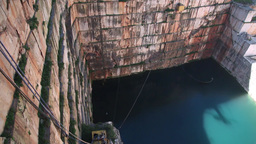 Blue water lake in marble stone quarry Footage