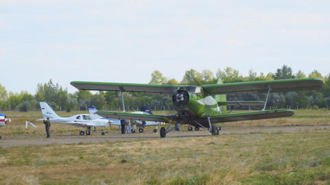 Old biplane plane on the runway Live Action