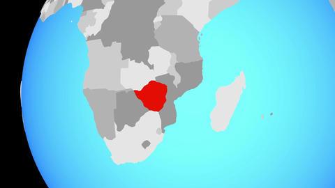 Closing in on Zimbabwe on blue globe Animation