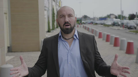 Wow facial expression of businessman standing on public street showing amazement Footage