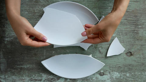 pile of broken white plates on rotating plate Live Action