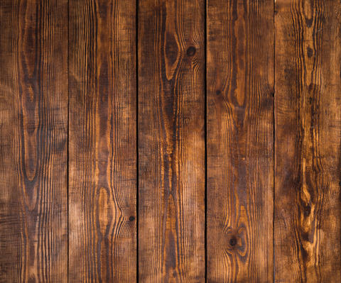 Old wooden surface with scratches and chips フォト